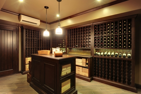 Queens Ln. Custom Wine Cellar with tasting table in center.
