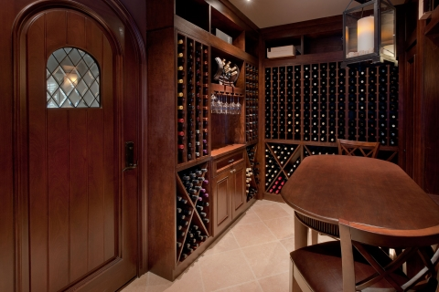 Beautifully stained custom woodwork in wine cellar.