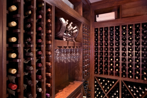 Side view of wine cellar centerpiece with elegant glassware display.