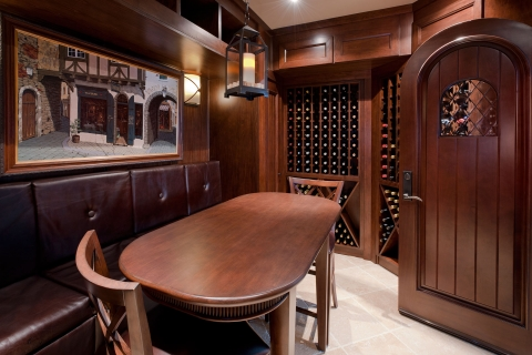 Comfortable tasting area in custom wine cellar with ample seating.