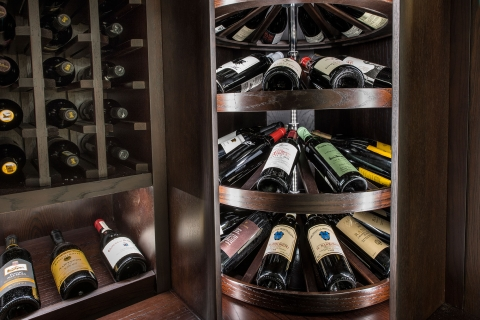 Wine racks with corresponding rotating wine cradles for functionality and appearance.