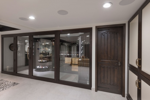 Wine cellar with solid wood side door.