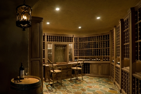 Partial entry view of classical custom wine cellar.