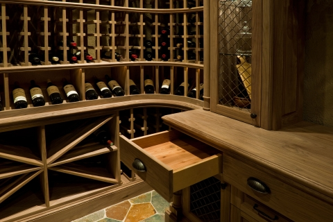 Elegant Cedar finishing inside furniture-grade, wine cellar drawers.