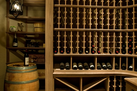 Efficient space usage showcased on left with shelving for wine storage.