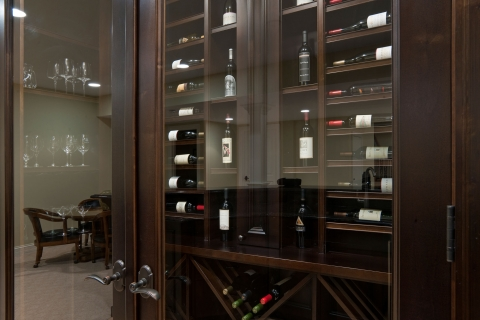 Custom-made double glass door enhances presentation of various wines.