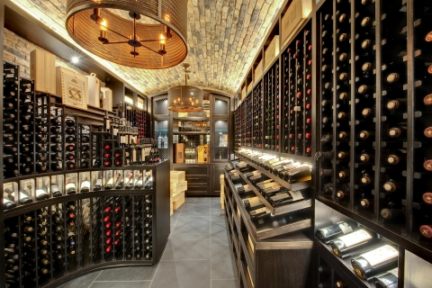 Custom wine cellar featuring curved waterfall cabinetry and furniture-grade Mahogany.