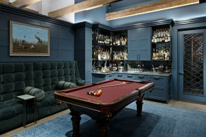 Custom Wall Paneling, Cabinetry and Wine Cellar Door